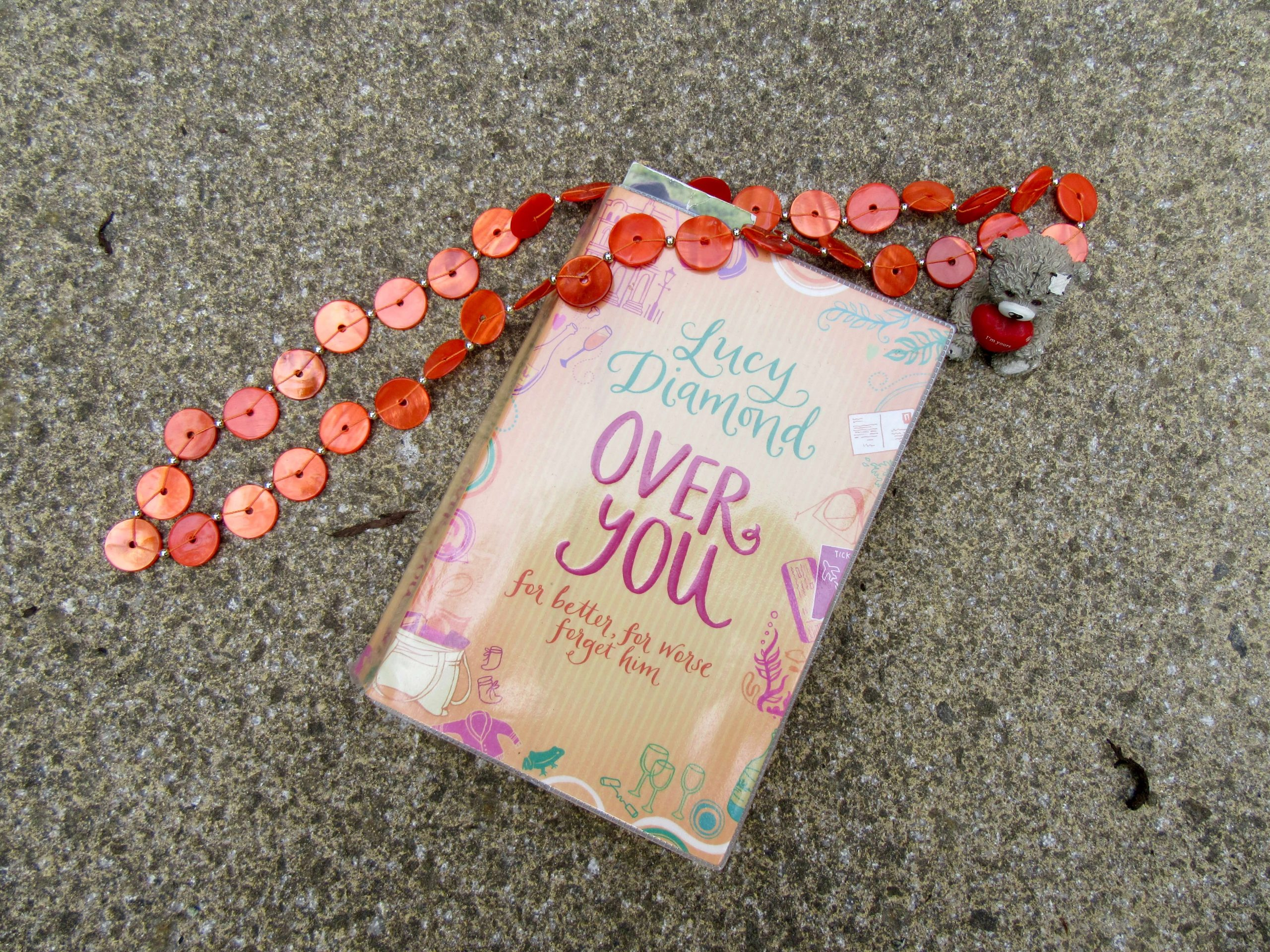 mid year book tag picture of a book, necklace and teddy bear holding a heart ornament